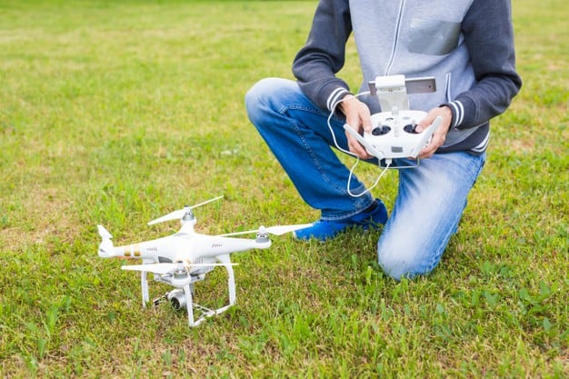 https://www.preflight.co.il/wp-content/uploads/2021/05/man-operating-drone-flying-hovering-by-remote-control-nature_230311-19388.jpeg