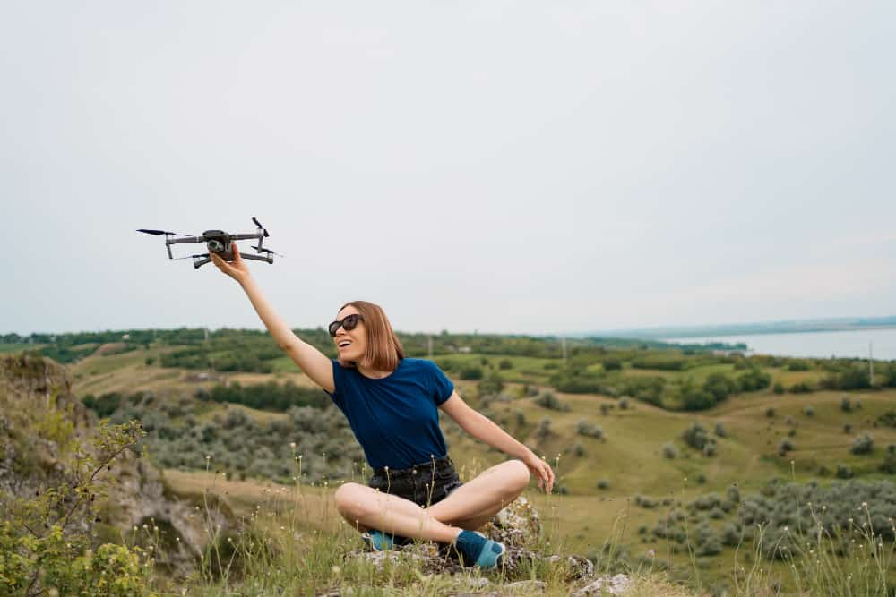 https://www.preflight.co.il/wp-content/uploads/2021/06/caucasian-woman-with-drone-her-hand-sitting-green-rocky-hill-with-sky-background.jpg