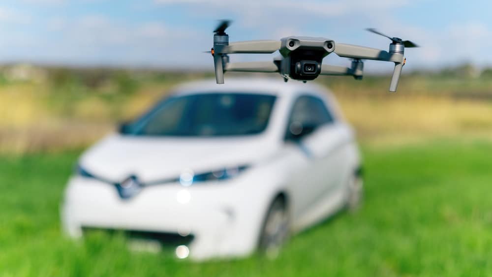 https://www.preflight.co.il/wp-content/uploads/2021/06/flying-drone-shooting-parked-electric-car-nature.jpg